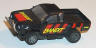 Tyco Nissan pickup truck in black with red and yellow 'Bandit'