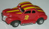 Tyco HP2 '40 Ford coupe, red with yellow stripes.