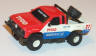 Tyco Nissan pickup truck in white with blue and red #27